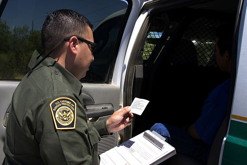CBP_Border_Patrol_agent_reads_the_Miranda_rights